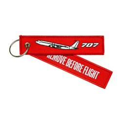Keyholder with `Remove Before Flight ` on one side and `707' and silhouette on other side