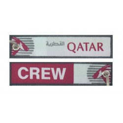 Keyholder with Qatar on one side and Qatar crew on other side