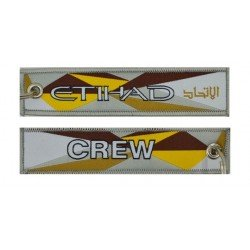 Keyholder with Etihad on one side and Etihad crew on other side